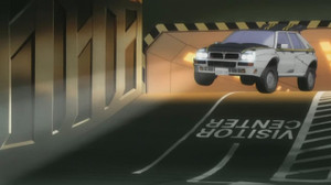 オズマの車は間違いなくイタリアのランチア・デルタ(旧型)だね。